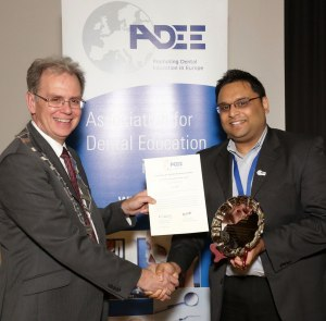 Upen Patel receiving his award