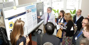Prof White judging the posters
