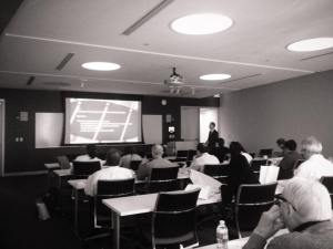 Damien Walmsley presenting at Tufts Dental School