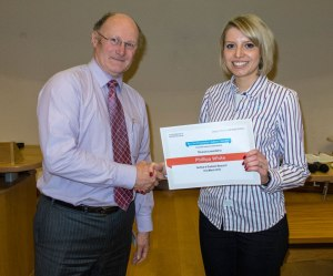 Pip receives her prize from Eric Jenkinson, Head of the coll